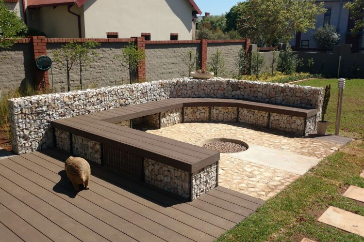 Firepit entertainment area with gabion decking seats
