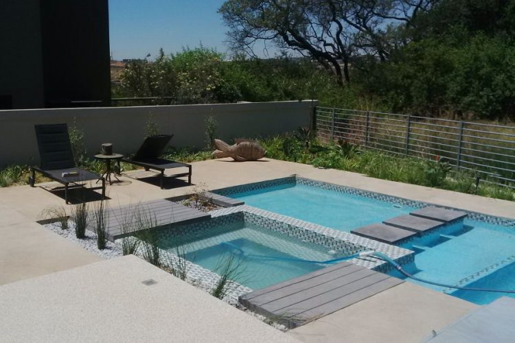 Floating flagstones in contemporary pool