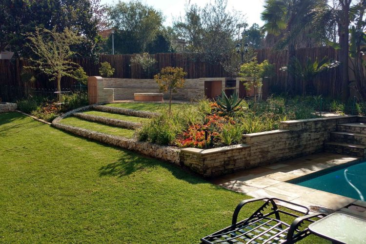 Firepit outdoor entertainment area with gabion lawn steps